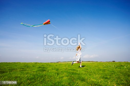 A young girl flying her kite