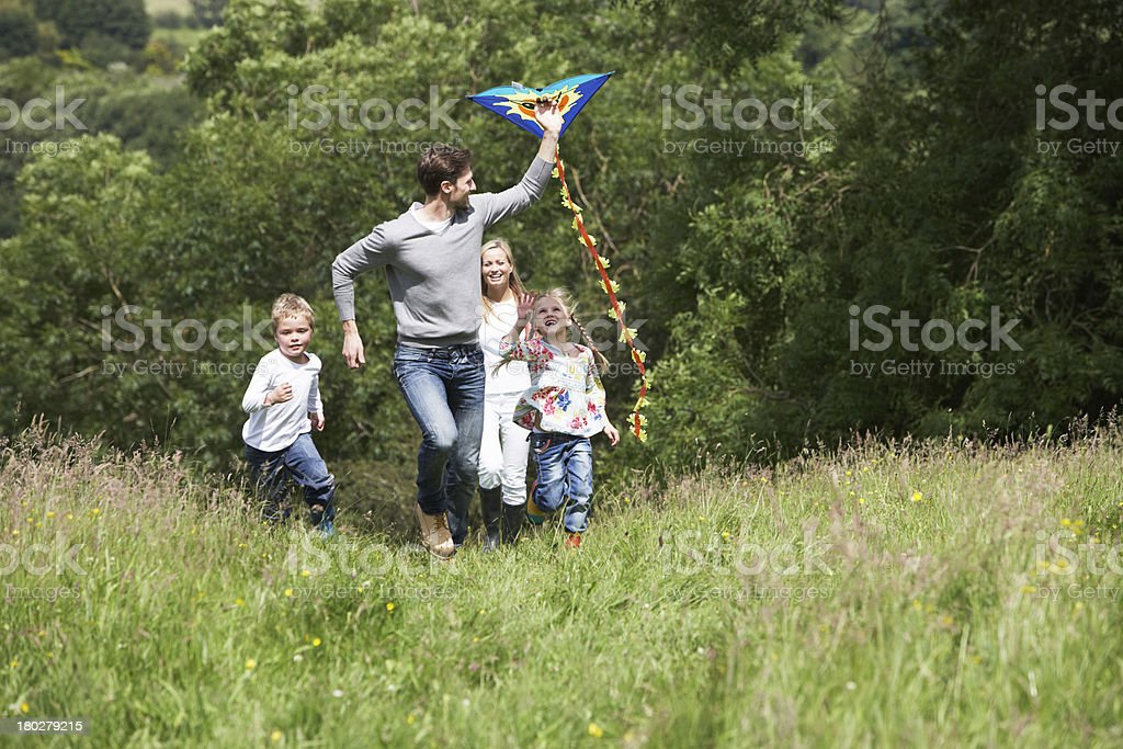 Kite flying with the family at the park stock photo