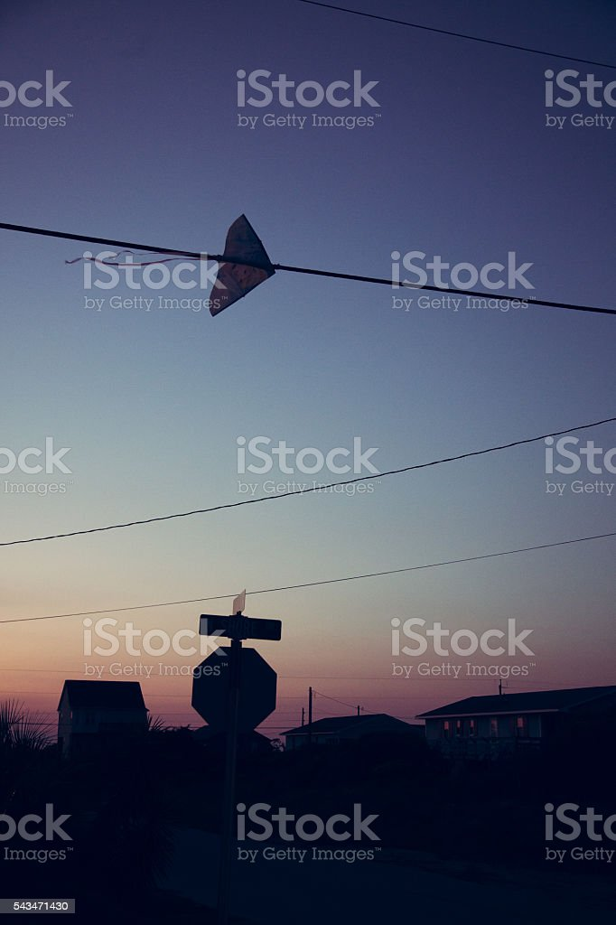 Kite in power lines stock photo