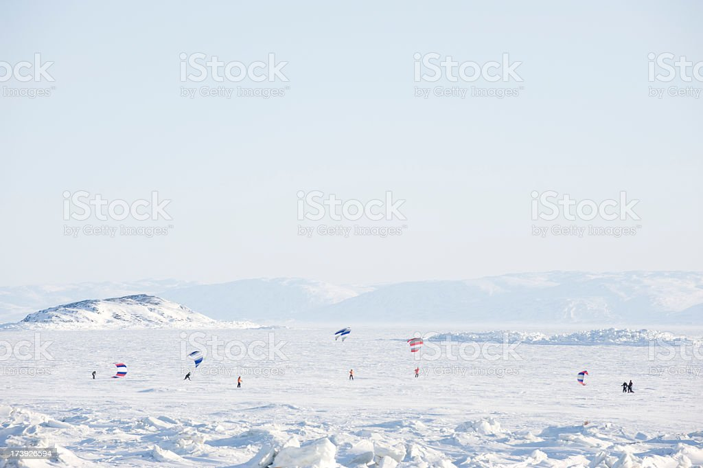 Kite Skiing on Frobisher Bay, Baffin Island. stock photo