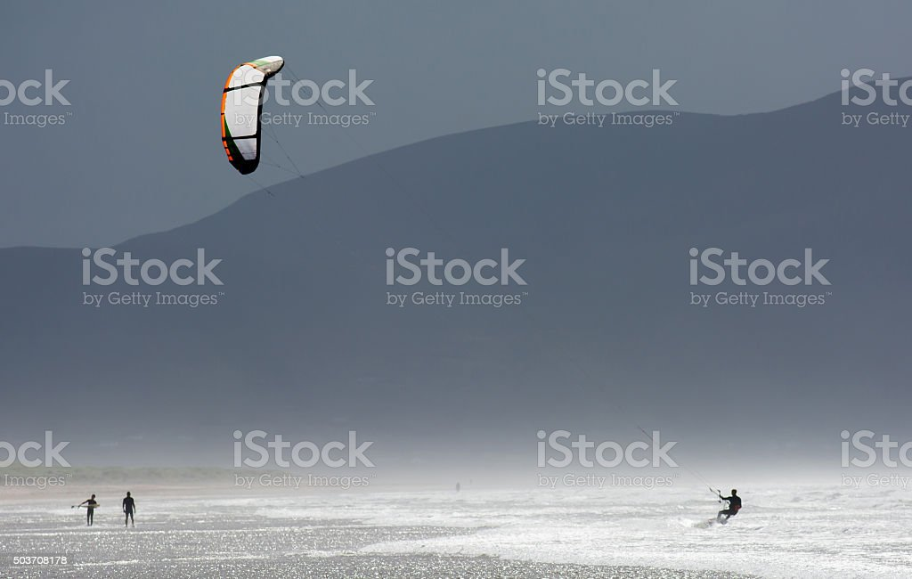 Kite Surfer in the Waves at the Coast of Ireland stock photo