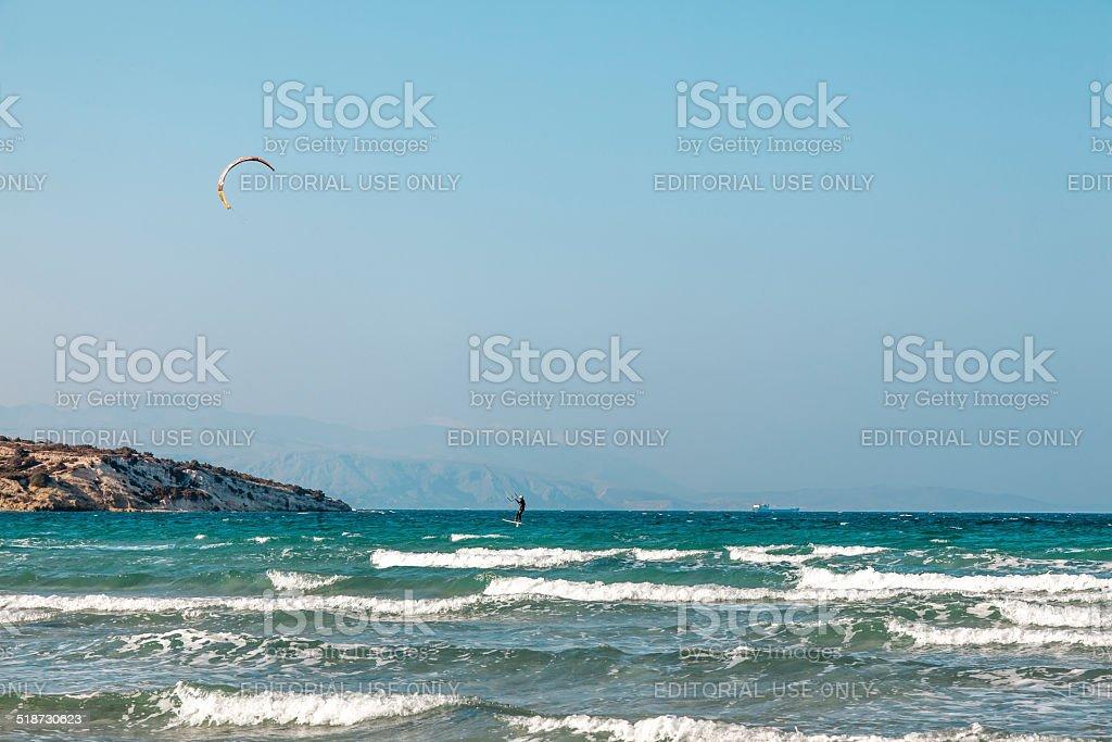 Kite surfer kitesurfing over the aegean sea stock photo