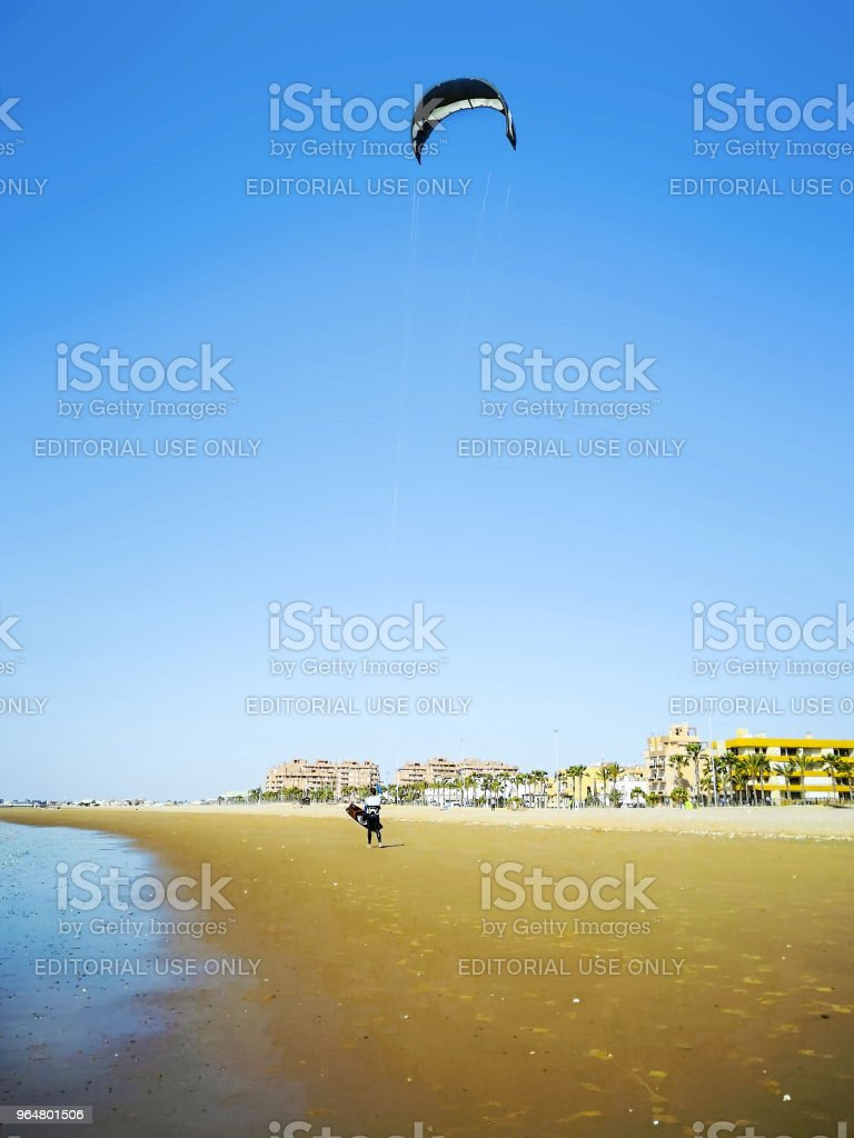 Kite surfer on the ocean beach. royalty-free stock photo