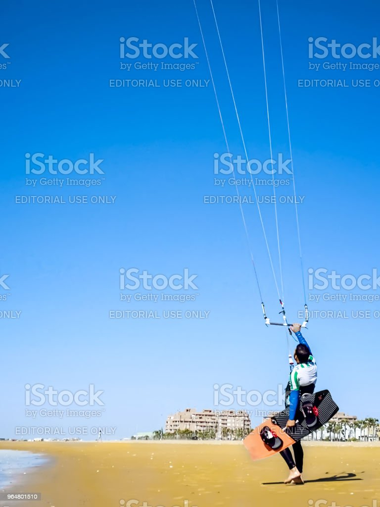 Kite surfer on the ocean beach. royalty-free stock photo