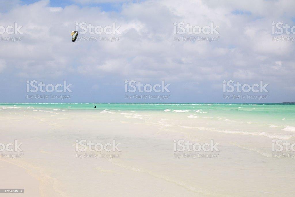 Kite surfer surfing on beautiful beach royalty-free stock photo