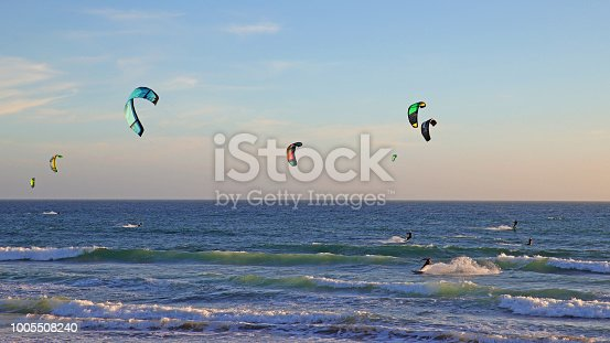 Kite surfers at dusk