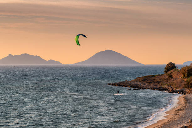 Kite surfing in the sea at sunset stock photo