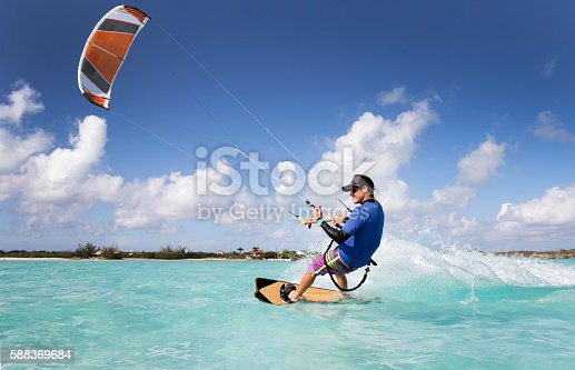 A man kite surfing in the Caribbean.