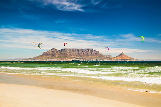 kitebarding near table mountain and cape town in south africa - table mountain south africa stock pictures, royalty-free photos & images
