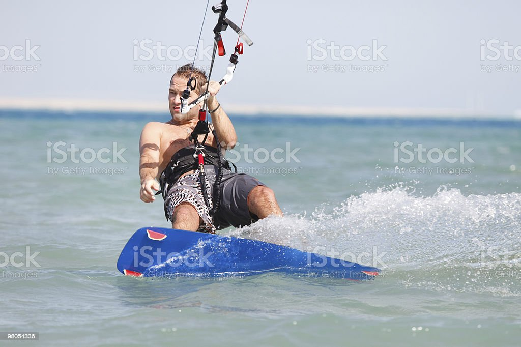 Kiteboarder enjoying surfing royalty-free stock photo
