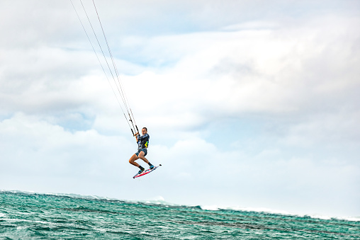 Kiteboarder flying in the air.