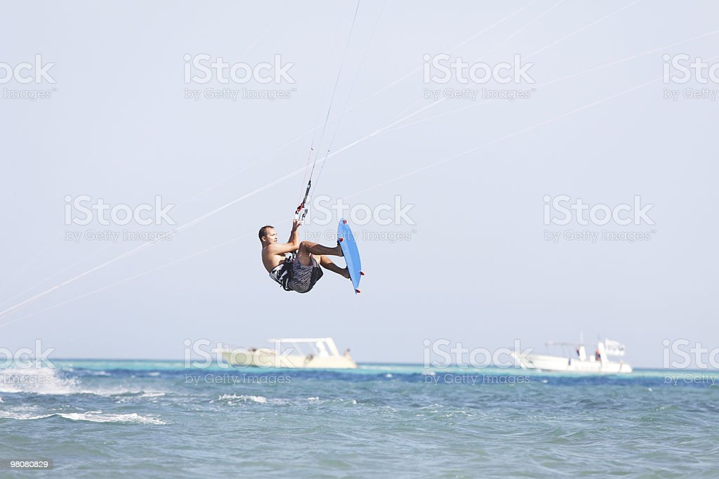 Kiteboarder jumps royalty-free stock photo