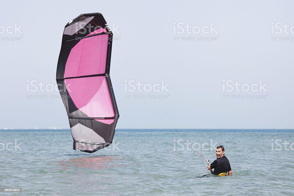 Kiteboarder lifting kite royalty-free stock photo