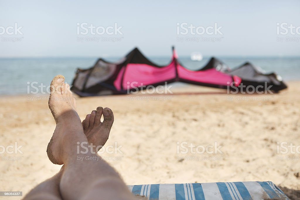 Kiteboarder waiting for wind royalty-free stock photo