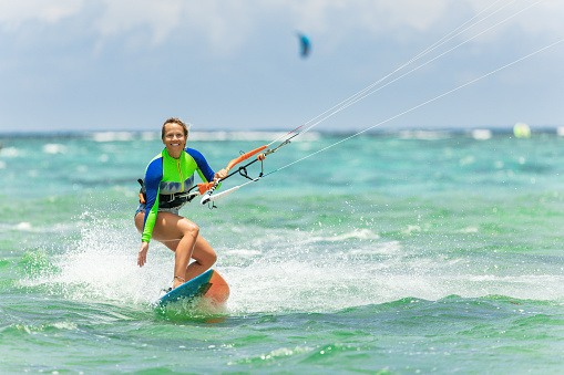 kiteboarding girl in beautiful water