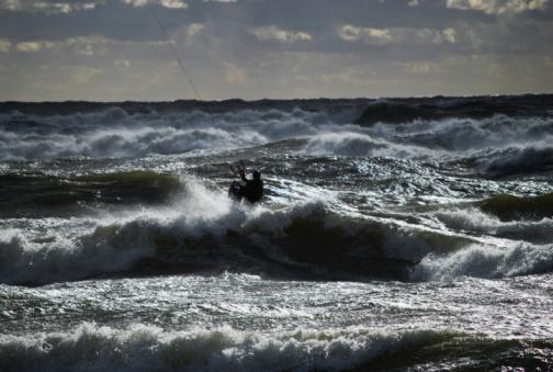 Kiteboarding in stormy sea
