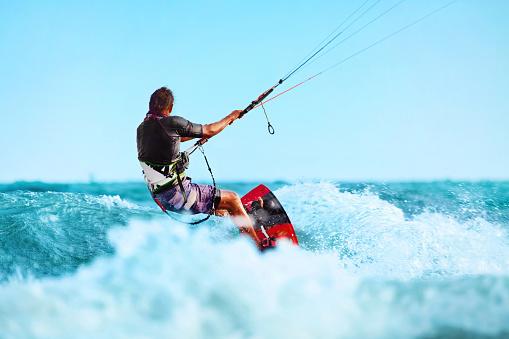 Kiteboarding, Kitesurfing. Water Sports. Kitesurf Action On Wave