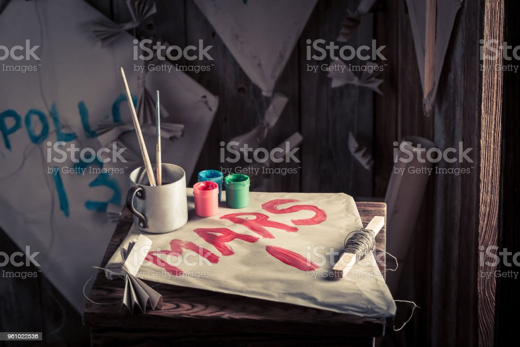 Kites and paints with space missions names stock photo