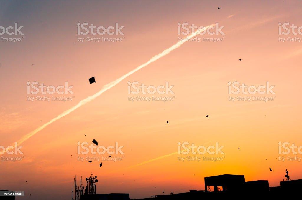 Kites flying at sunset stock photo