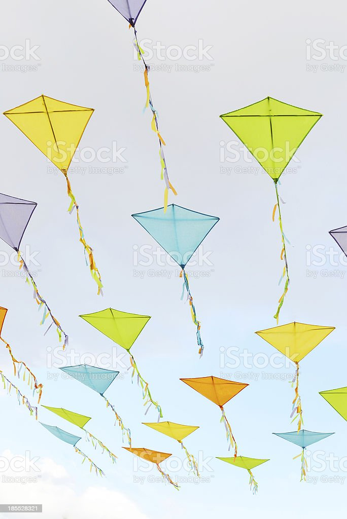 Kites in the clouds against a blue sky royalty-free stock photo