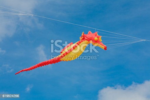 Kite competition on a sunny hot day. Colorful, creative kites fly against a deep blue sky in the caribbean
