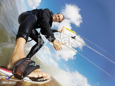 A smart kitesurfer, raising his thumb for kitesurfig in the northsea of St.Peter-Ording in Germany. GoPro Hero 4 black edition image.