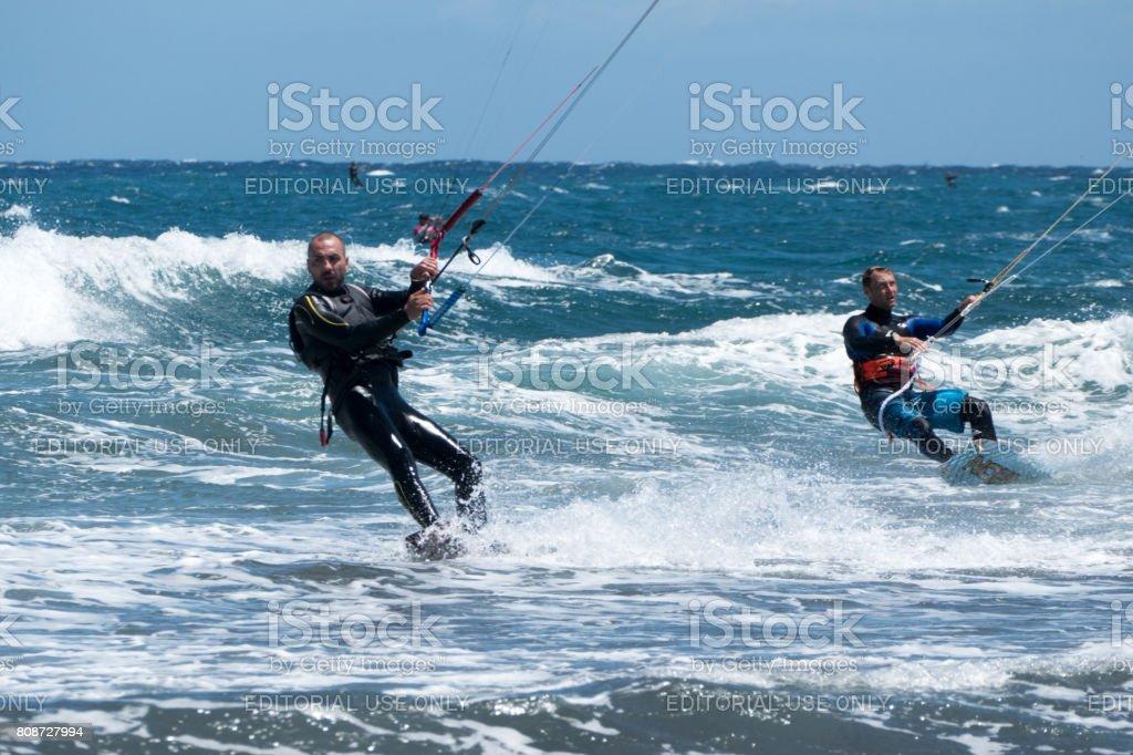 Kitesurfen on the beach El Medano-Tenerife, Spain stock photo