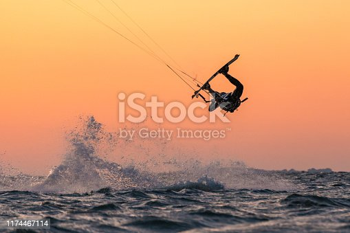 Kitesurfer doing unhooked tricks in beautiful sunset conditions and nice colors