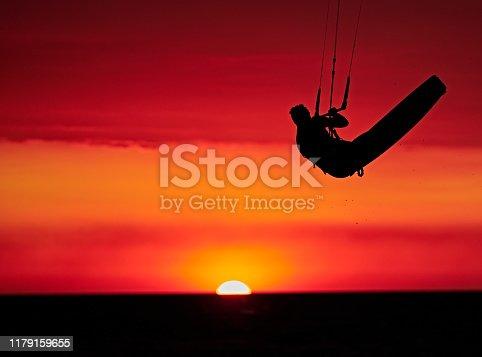 Kitesurfer Sailing on the sunset