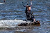 REWA, POLAND - CIRCA MAY 2020: Kitesurfers playing sports in the Puck Bay on the Baltic Sea circa May 2020 in Rewa.