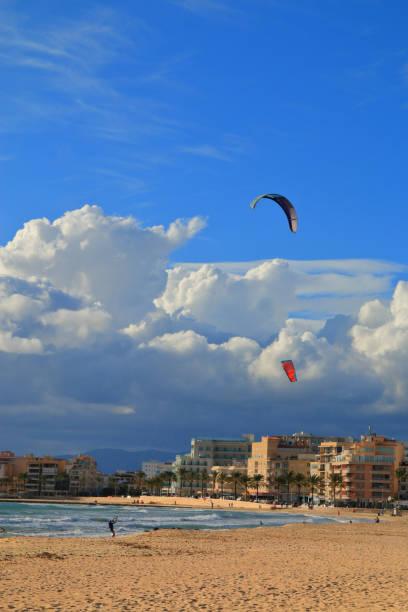 Kitesurfing on the beach of the island of Palma de Mallorca.