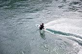 Unidentified man kitesurfing on Lake Neuchatel in Switzerland.