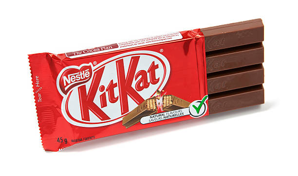 kitkat chocolate candy bar unwrapped - kit kat stock photos and pictures