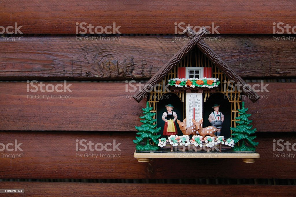 Kitschy german weather house stock photo