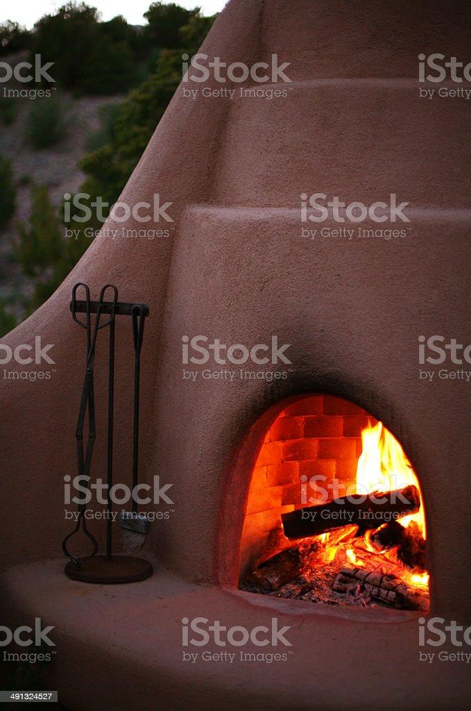 Kiva Fireplace Adobe with Burning Embers stock photo