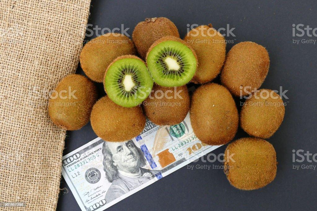 kiwi and hundred dollars stock photo