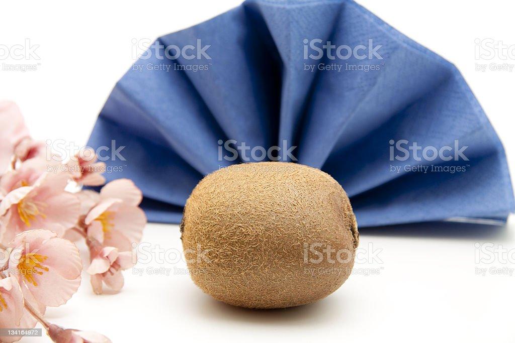 Kiwi before blue folded napkin royalty-free stock photo