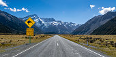 A kiwi bird sign on the road to Mt Cook National Park, south island of New Zealand, seen during a summer day in these southern alps.