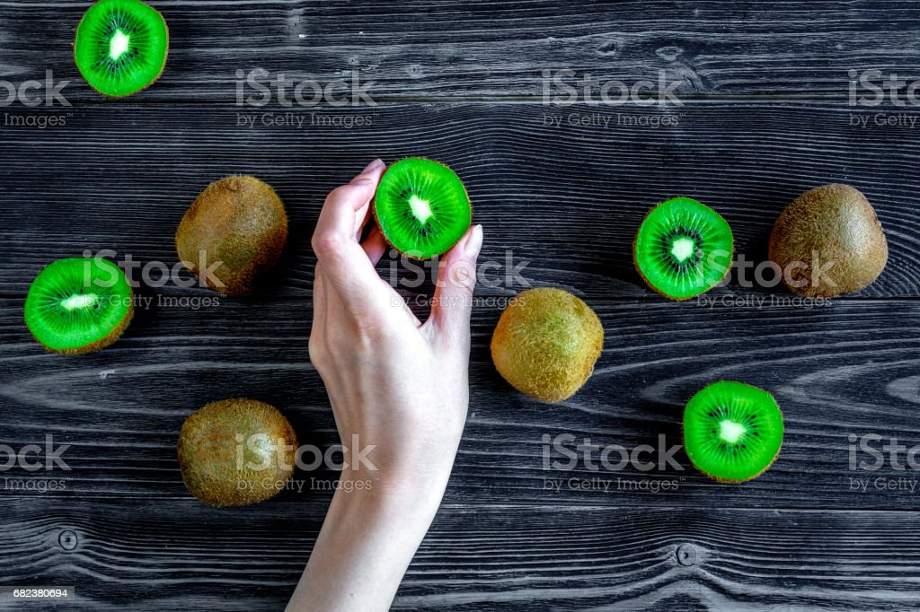 kiwi for healthy fruit dessert on dark table background top view royalty-free stock photo
