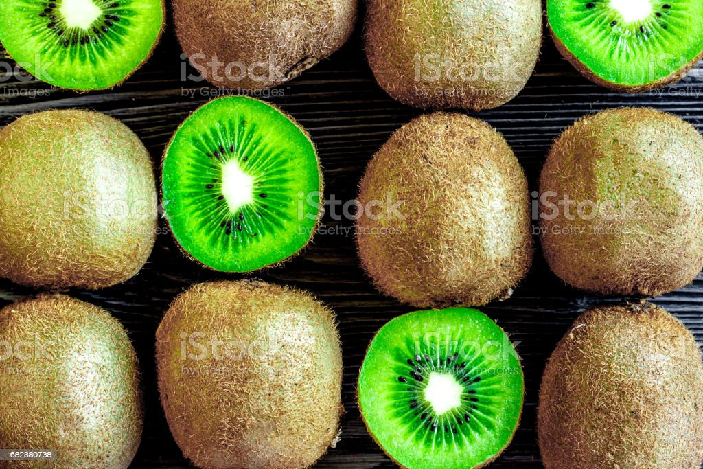 kiwi for healthy fruit dessert on dark table background top view pattern royalty-free stock photo