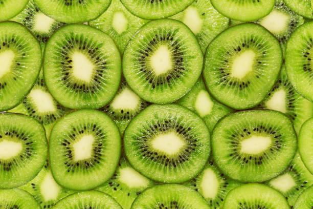 kiwi fruit background - kiwi imagens e fotografias de stock