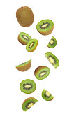 Kiwi fruit falling isolated on white background with clipping path.