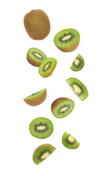 kiwi fruit falling isolated on white background with clipping path - kiwi imagens e fotografias de stock