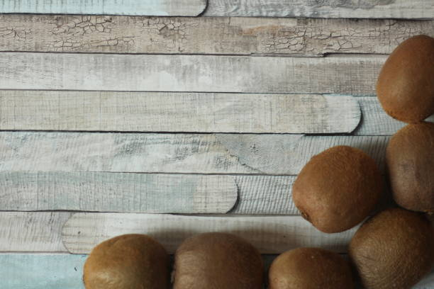 Kiwi fruit on a wooden background stock photo