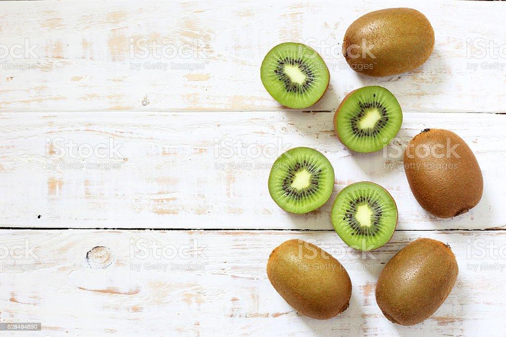 Kiwi fruit on white wooden background stock photo