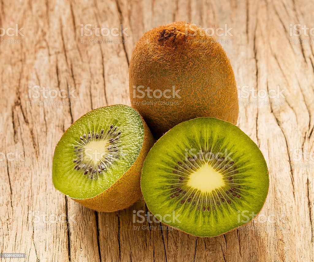 Kiwi fruit placed on wooden planks ,Thailand stock photo