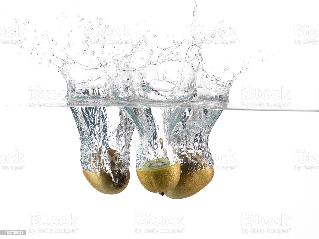 Kiwi Fruit, Splashing in Water royalty-free stock photo