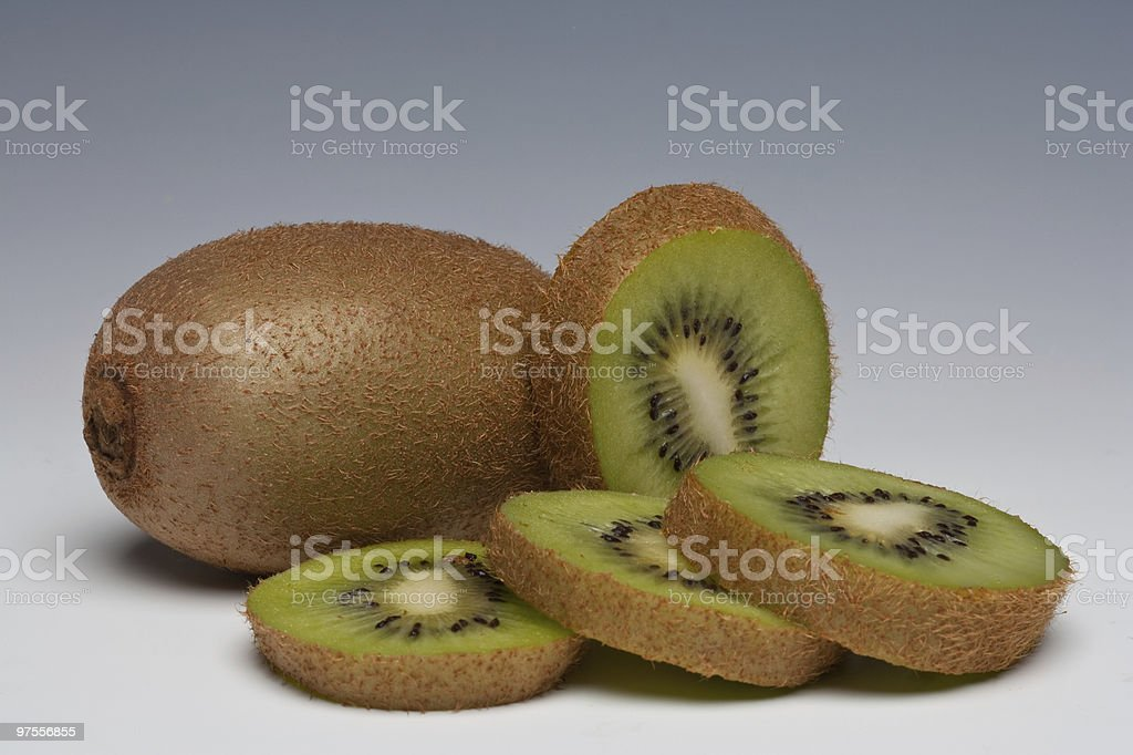 Kiwi Fruit whole and sliced royalty-free stock photo