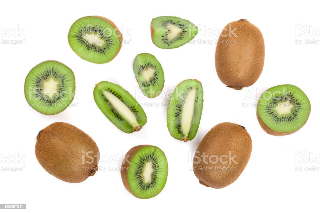 Kiwi fruit with slices isolated on white background, close-up. Top view. Flat lay pattern stock photo