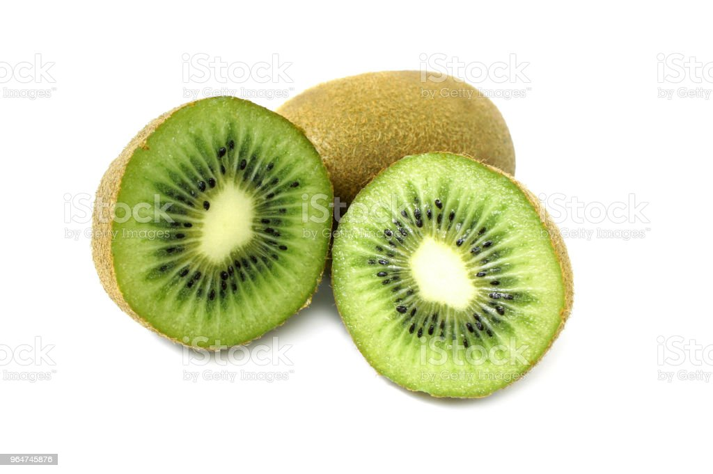 Kiwi halves on a white background. Close up. royalty-free stock photo